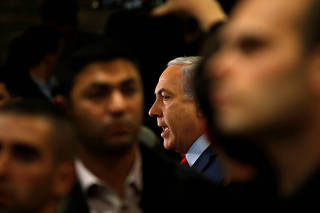 Israeli Prime Minister Benjamin Netanyahu speaks to the media at the Knesset, Israel's parliament, in Jerusalem