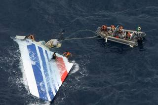 File picture of Brazilian Navy sailors picking a piece of debris from Air France flight AF447 out of the Atlantic Ocean