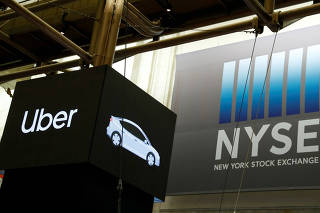 FILE PHOTO: Uber Technologies Inc banner during the company's IPO at the NYSE in New York