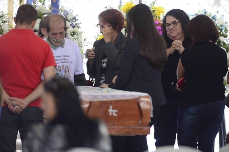 Na casa ficou um vazio, dizem amigos em velório de família morta no Chile