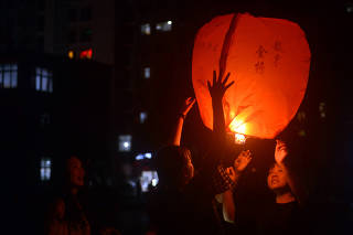 Students release a sky lantern to pray for the upcoming annual national college entrance exam, or