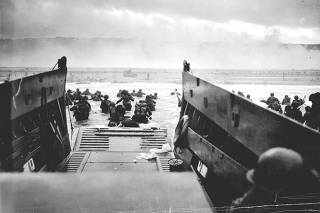 FILE PHOTO: Handout photo of U.S. troops wading ashore from a Coast Guard landing craft at Omaha Beach during the Normandy D-Day landings near Vierville sur Mer