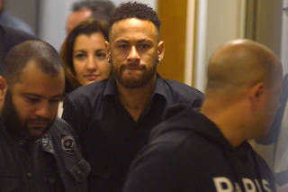 Brazilian soccer player Neymar leaves the police station after testifying in Rio de Janeiro