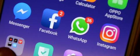 (FILES) In this file photo taken on March 22, 2018 This photo illustration taken on March 22, 2018 shows apps for Facebook, Instagram, Whatsapp and other social networks on a smartphone in Chennai. - Instant messaging service WhatsApp notified the Irish data protection authority of a security breach which may have allowed a