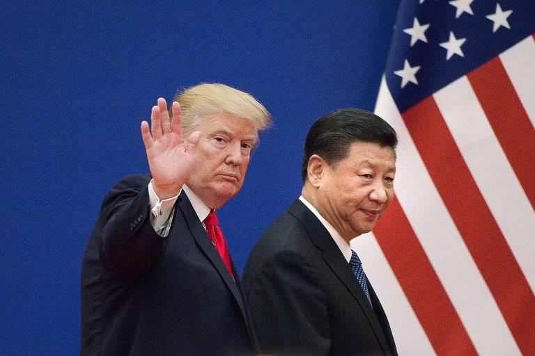 O presidente americano, Donald Trump, à esq., com Xi Jinping em visita à China