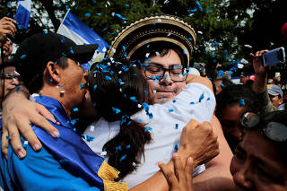 Oppostion leader Yubrank Suazo, who according to local media was arrested for participating in a protest against Nicaraguan President Daniel Ortega's government, is greeted by neighbors after being released from La Modelo Prison, in Masaya