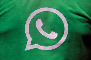 FILE PHOTO: A logo of WhatsApp is pictured on a T-shirt worn by a WhatsApp-Reliance Jio representative during a drive by the two companies to educate users, on the outskirts of Kolkata