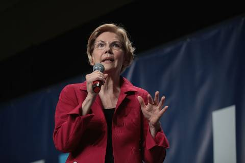 CEDAR RAPIDS, IOWA - JUNE 09: Democratic presidential candidate Senator Elizabeth Warren (D-MA) speaks at the Iowa Democratic Party's Hall of Fame Dinner on June 9, 2019 in Cedar Rapids, Iowa. Nearly all of the 23 Democratic candidates running for president were campaigning in Iowa this weekend. President Donald Trump has two events scheduled in the state on Tuesday.   Scott Olson/Getty Images/AFP