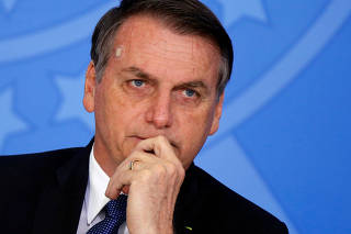 Brazil's President Jair Bolsonaro attends a ceremony of the Brazilian National Development Bank (BNDES) Line of Credit for Philanthropic Organizations at the Planalto Palace in Brasilia