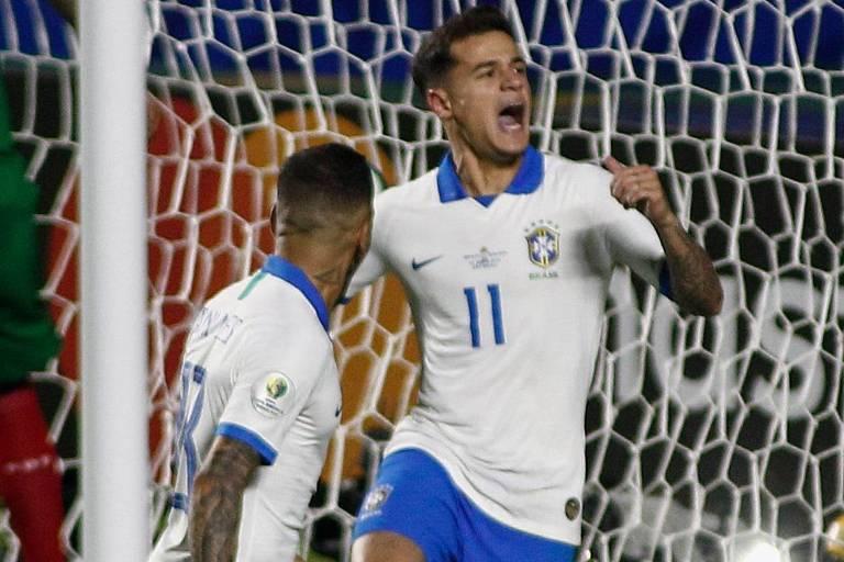 O meia-atacante Philippe Coutinho comemora o seu primeiro gol.