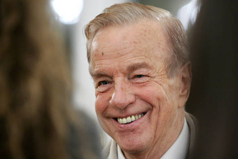 FILE PHOTO: Italy's film director Franco Zeffirelli smiles during a ceremony at the British Embassy in Rome November 24, 2004. [Zeffirelli, the legendary filmmaker who has directed stars like Elizabeth Taylor and Placido Domingo, is the first Italian to receive an honorary knighthood from Britain.] - PBEAHUOEKCX/File Photo ORG XMIT: FW1