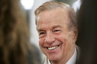 FILE PHOTO: Italy's film director Franco Zeffirelli smiles during a ceremony at the British Embassy in Rome Nove..