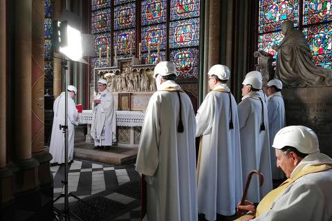 The Archbishop of Paris Michel Aupetit, holds the first mass in a side chapel two months to the day after a devastating fire engulfed the Notre-Dame de Paris cathedral on June 15, 2019, in Paris. - The Notre-Dame cathedral in Paris will host its first mass on June 15, 2019, exactly two months after the devastating blaze that shocked France and the world. For safety reasons, the mass led by Archbishop of Paris Michel Aupetit will be celebrated on a very small scale. Worshippers will be expected to don hard hats but priests will be wearing their ceremonial garb. (Photo by Karine PERRET / POOL / AFP)
