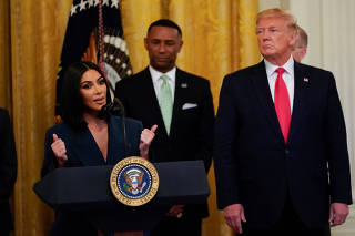 Kardashian joins Trump onstage to speak about second chance hiring, at the White House in Washington