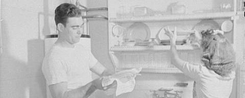 """The Smiths share the drudgery of housework, for they both have important war jobs,"" the Office of War Information wrote about this photo circa 1944"