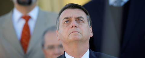 Brazil's President Jair Bolsonaro attends a ceremony of hoisting the national flag in front the Planalto Palace in Brasilia, Brazil June 18, 2019. REUTERS/Adriano Machado ORG XMIT: GGGAHM03