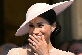 FILE PHOTO: Meghan, Duchess of Sussex attends a garden party at Buckingham Palace, in London