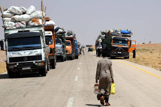 SYRIA-HOMS-REFUGEES-RUTURN
