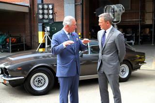Britain's Prince Charles visits the set of James Bond at Pinewood Studios