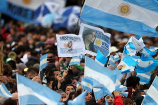 Supporters of Argentina's former President Cristina Fernandez de Kirchner chant slogans before a rally in Merlo, in Buenos Aires