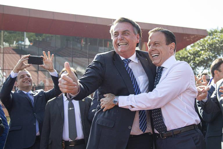 Jair Bolsonaro e João Doria antes de assinatura de Termo de Compromisso entre a Caixa e o Comitê Paralímpico Brasileiro, no Centro Paraolímpico, em São Paulo