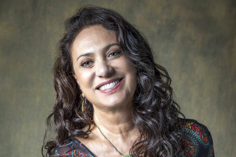 Rania Nasser ( Eliane Giardini )