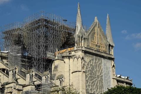 A picture taken on May 31, 2019 shows scaffoldings set up on Notre-Dame de Paris cathedral, under repair after it was badly damaged by a huge fire on April 15, in the French capital Paris. (Photo by Bertrand GUAY / AFP)