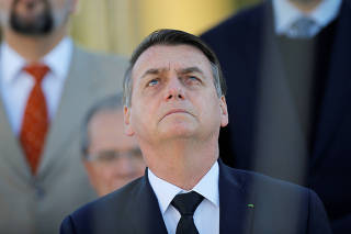 Brazil's President Bolsonaro attends a ceremony of hoisting the national flag in front the Planalto Palace in Brasilia