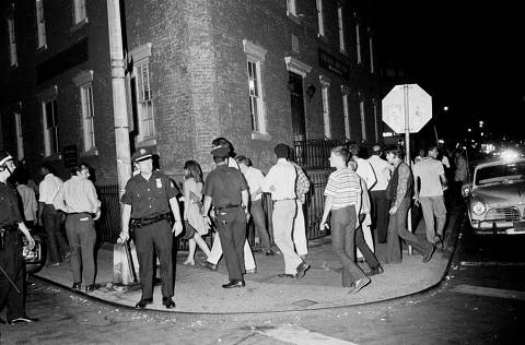 ALTA TIMES*** FILE -- Police officers try to clear a crowd at Seventh Avenue South and Christopher Street, near the Stonewall Inn, in New York on July 2, 1969, several days after the club was raided. ?If what I did helped gay people, then I?m glad,? said Deputy Inspector Seymour Pine, who led the Police Department?s raid on the Stonewall Inn. (Larry Morris/The New York Times) ORG XMIT: XNYT69