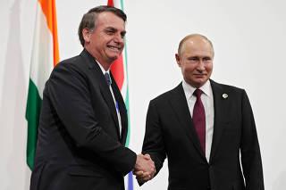 Russia's President Putin and Brazil's President Bolsonaro attend the BRICS summit in Osaka