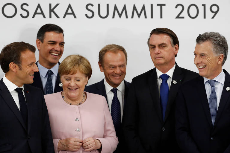 A partir da esq.: o presidente francês Emmanuel Macron, o primeiro ministro da Espanha Pedro Sanchez, a chanceler alemã Angela Merkel, o presidente do Conselho da UE Donald Tusk, o presidente do Brasil Jair Bolsonaro, e o presidente da Argentina Mauricio Macri