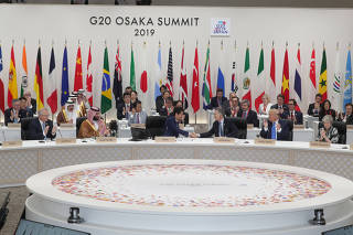 G20 leaders and delegates attend the closing session of G20 leaders summit in Osaka