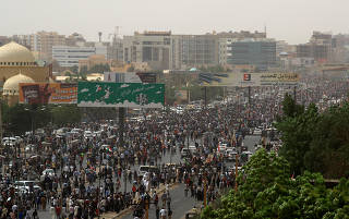 Tens of thousands of people march on the streets demanding the ruling military hand over to civilians, in the largest demonstrations since a deadly security service raid on a protest camp three weeks ago, in Khartoum
