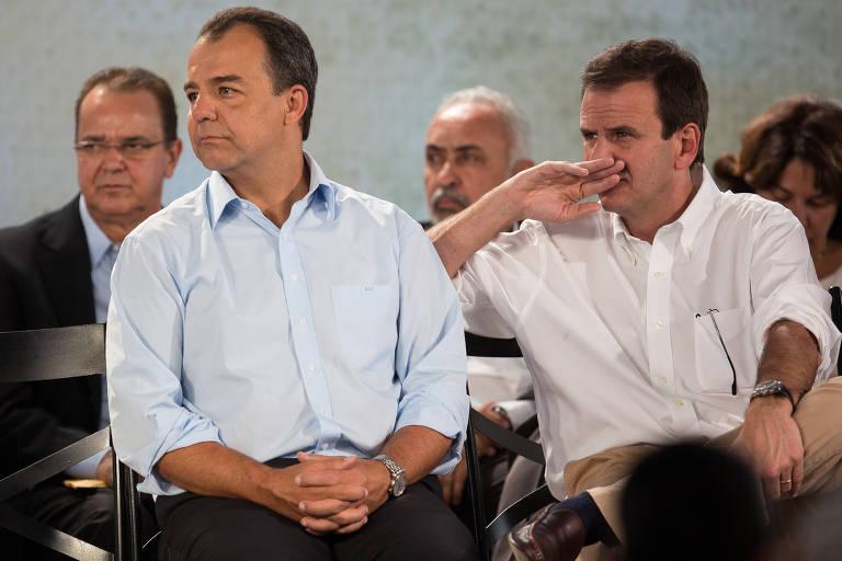 O ex-governador Sérgio Cabral e o ex-prefeito Eduardo Paes durante evento no Rio em 2013