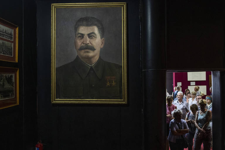 **EMBARGO: No electronic distribution, Web posting or street sales before 3:00 a.m. ET Sunday June 30, 2019. No exceptions for any reasons. EMBARGO set by source.** Tourists at the Joseph Stalin Museum, in the Soviet dictator's home town of Gori, Georgia, May 6, 2019. The tone throughout the museum is admiring, a stirring narrative about a poor kid who, against long odds soared to the heights of power. Omitted are his millions of victims. (Daro Sulakauri/The New York Times)