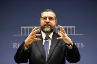 Brazil's Foreign Minister Ernesto Araujo gestures during a news conference at the Itamaraty Palace in Brasilia