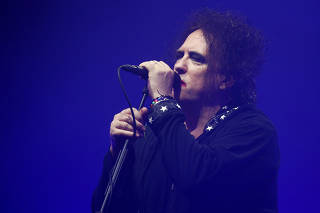 Robert Smith of the British band The Cure performs the Pyramid Stage closing set during Glastonbury Festival in Somerset
