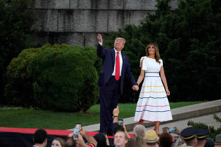 U.S. President Donald Trump and first lady Melania Trump arrive for the