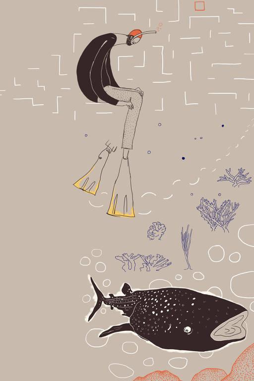 homem submerso com peixe