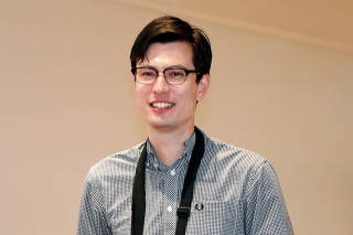 Australian student Alek Sigley arrives at Haneda International Airport in Tokyo