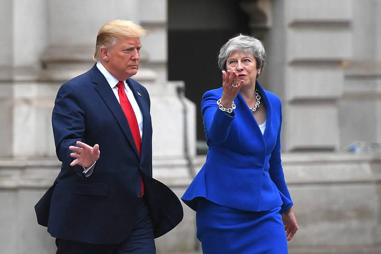 Foto de 4 de junho mostra Donald Trump com Theresa May em Londres