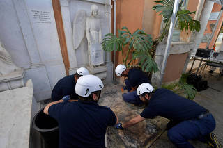 People open tombs in a cemetery on the Vatican's grounds