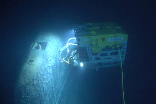 Remotely operated vehicle called Aegir 6000 examines the wreck of the Soviet nuclear submarine