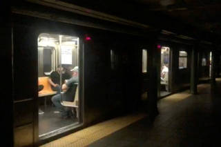 Passengers in a subway train at the 66th Street station during a blackout caused by widespread power outages, in this still frame taken from video, in the Manhattan borough of New York City