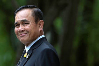 FILE PHOTO: Thai Prime Minister Prayuth Chan-ocha smiles before speaking to the media at Government House in Bangkok
