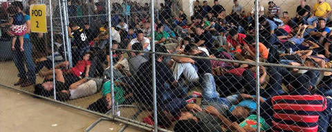 An overcrowded fenced area holding families at a Border Patrol station is seen in a still image from video in McAllen, Texas, U.S. on June 10, 2019 and released as part of a report by the Department of Homeland Security's Office of Inspector General on July 2, 2019. Picture pixelated at source. Office of Inspector General/DHS/Handout via REUTERS. ATTENTION EDITORS - THIS IMAGE WAS PROVIDED BY A THIRD PARTY. ORG XMIT: TOR520