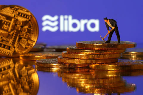 FILE PHOTO: A small toy figure stands on representations of virtual currency in front of the Libra logo in this illustration picture, June 21, 2019. REUTERS/Dado Ruvic/Illustration/File Photo ORG XMIT: FW1