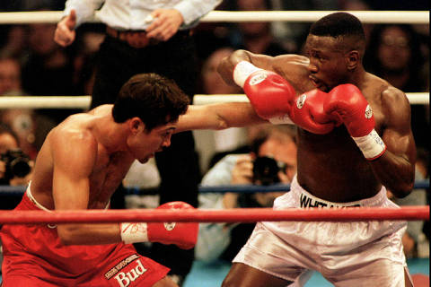 FILE PHOTO: Oscar De La Hoya (L) lands a punch to the body of Pernell Whitaker during their WBC Welterweight Championship fight in Las Vegas, April 12 1997. De La Hoya won the 12 round bout by unanimous decision to claim the championship. R. Marsh Starks/Reuters/File Photo ORG XMIT: FW1