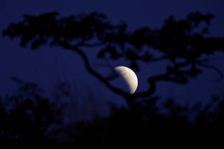 A moon is seen during a partial lunar eclipse in Brasilia
