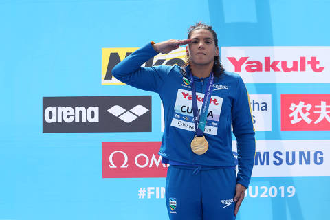 Swimming - 18th FINA World Swimming Championships - Women's 5km Open Water Medal Ceremony - Yeosu EXPO Ocean Park, Yeosu, South Korea - July 17, 2019.  Gold medallist Ana Marcela Cunha of Brazil salutes on podium. REUTERS/Evgenia Novozhenina ORG XMIT: GWA127